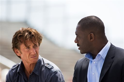 "This image released by Open Road Films shows Sean Penn, left, and Idris Elba in a scene from the film, ""The Gunman."" (AP Photo/Open Road Films, Keith Bernstein)"