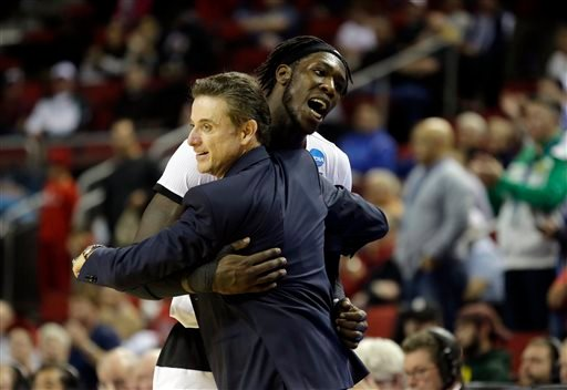 Louisville's Montrezl Harrell celebrates as he hugs Louisville head coach Rick Pitino late in the second half of an NCAA college basketball tournament game against Northern Iowa in the Round of 32 March 22, 2015, in Seattle. (AP Photo/Ted S. Warren)