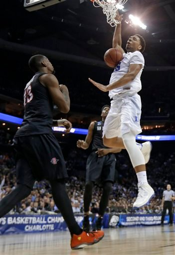 Duke's Jahlil Okafor, right, dunks against San Diego State's Winston Shepard, left, during the first half of an NCAA tournament college basketball game in the Round of 32 in Charlotte, N.C., Sunday, March 22, 2015. (AP Photo/Gerald Herbert)