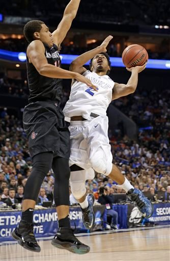Duke's Quinn Cook (2) shoots over San Diego State's Trey Kell (12) during the first half of an NCAA tournament college basketball game in the Round of 32 in Charlotte, N.C., Sunday, March 22, 2015. (AP Photo/Gerald Herbert)