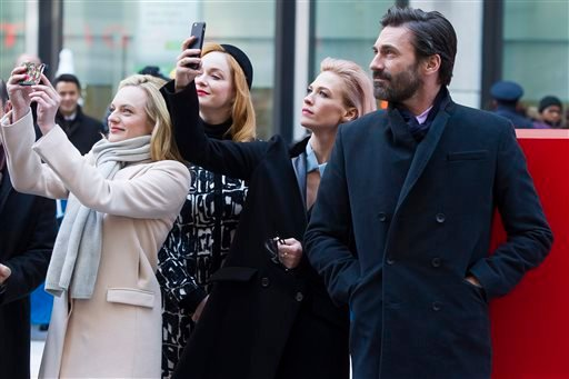 "Elisabeth Moss, from left, Christina Hendricks, January Jones and Jon Hamm attend an unveiling of a bench in honor of the ""Mad Men"" series in front of the Time & Life Building on Monday, March 23, 2015 in New York. (Photo by Charles Sykes/Invision/AP)"
