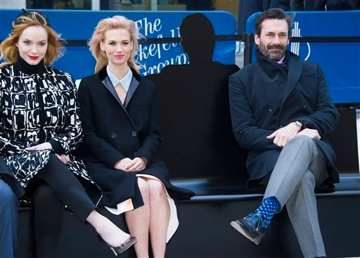"Christina Hendricks, from left, January Jones and Jon Hamm appear at an unveiling of a bench dedicated to the ""Mad Men"" series in front of the Time & Life Building on Monday, March 23, 2015 in New York. The bench shows a silhouette of Hamm's character Don"
