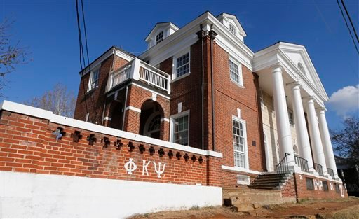 This Nov. 24, 2014 file photo shows the Phi Kappa Psi fraternity house at the University of Virginia in Charlottesville, Va. After a five-month police investigation into an alleged gang rape at the fraternity that Rolling Stone magazine described in graph
