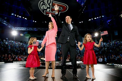 Sen. Ted Cruz, R-Texas, his wife Heidi, and their two daughters Catherine, 4, left, and Caroline, 6, right, wave on stage after he announced his campaign for president, Monday, March 23, 2015 at Liberty University, in Lynchburg, Va. Cruz, who announced hi