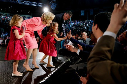 Sen. Ted Cruz, R-Texas and his wife Heidi watch as their daughter Caroline, 6, center, high-fives members of the crowd after Cruz announced his campaign for president, Monday, March 23, 2015, at Liberty University, founded by the late Rev. Jerry Falwell,
