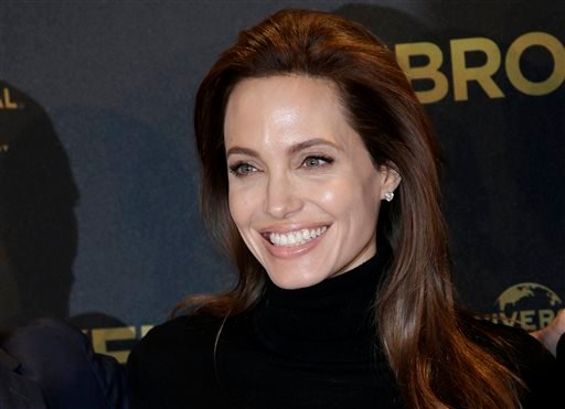"""Nov. 27, 2014 file photo: Director Angelina Jolie poses for photographers during a photo call for her film """"Unbroken"""" in Berlin, Germany. (AP Photo/Michael Sohn, File)"""
