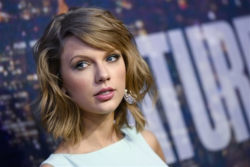 In this Feb. 15, 2015 file photo, singer Taylor Swift attends the SNL 40th Anniversary Special in New York.