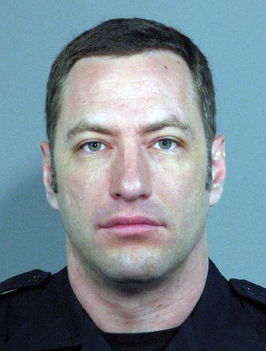 Officer Michael Johnson, a 14-year veteran San Jose police officer, was killed Tuesday, March 24, 2015, after he responded to an apartment complex in the 2600 block of Senter Road in San Jose, Calif.