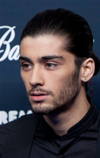 In this Friday, Dec. 12, 2014 file photo, Zayn Malik, from the British band One Direction poses for photographers during a photocall before the gala of the '40 Principales Awards 2014' at Palacio de los Deportes in Madrid, Spain.