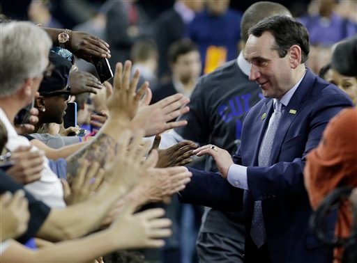 Duke head coach Mike Krzyzewski celebrates with fans after a college basketball regional final game against Gonzaga in the NCAA Tournament Sunday, March 29, 2015, in Houston. Duke won 66-52 to advance to the Final Four. (AP Photo/David J. Phillip)