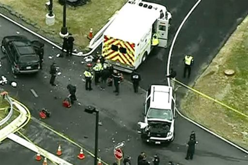 In this image made from video and released by WJLA-TV, authorities investigate the scene of a accident near a gate to Fort Meade, Md., on Monday, March 30, 2015. (AP Photo/WJLA-TV)