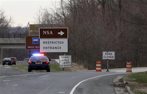 A Maryland State Police cruiser sits at a blocked southbound entrance on the Baltimore-Washington Parkway that accesses the National Security Agency March 30, 2015, in Fort Meade, Md. (AP Photo/Patrick Semansky)