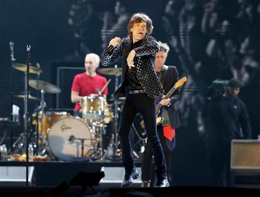 FILE - This Feb. 26, 2014 file photo shows Mick Jagger and the Rolling Stones performing during their concert at Tokyo Dome in Tokyo. (AP Photo/Shizuo Kambayashi, File)