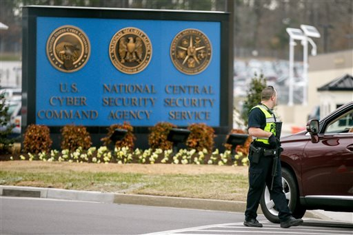A police officer directs a vehicle to turn away at the National Security Agency, Monday, March 30, 2015, in Fort Meade, Md. (AP Photo/Andrew Harnik)