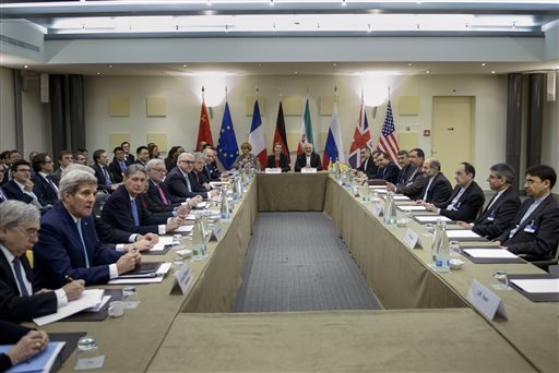 Iranian Foreign Minister Javad Zarif, center right, European Union High Representative Federica Mogherini, center left, and other officials from Britain, China, France, Germany, Russia and the United States wait for the start of a meeting on Iran's nuclea