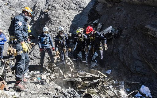 March 31, 2015 photo provided by the French Interior Ministry, French emergency rescue services work among debris of the Germanwings passenger jet at the crash site near Seyne-les-Alpes. (AP Photo/Yves Malenfer, Ministere de l'Interieur)