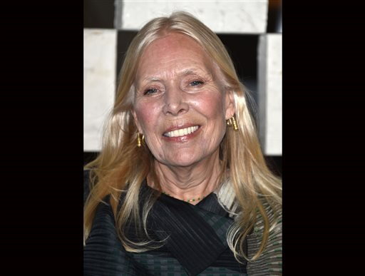 """FILE - Joni Mitchell arrives to the Hammer Museum's """"Gala In The Garden"""" in this Saturday, Oct. 11, 2014 file photo taken in Los Angeles. (Photo by John Shearer/Invision/AP, File)"""