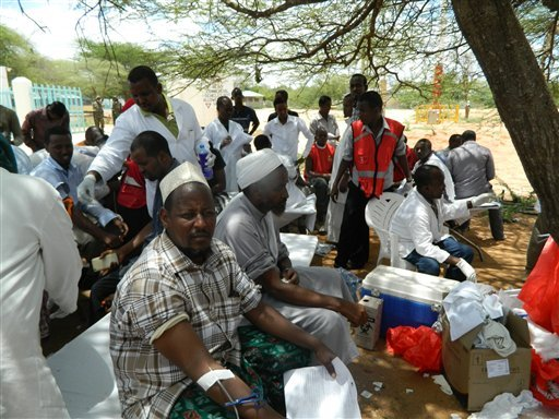 Local residents donate blood at Garissa hospital April 2, 2015. Al-Shabab gunmen attacked Garissa University College in northeast Kenya early targeting Christians and killing at least 15 people and wounding 60 others, witnesses said. (AP Photo)