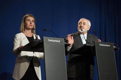 Iranian Foreign Minister Javad Zarif, right, delivers a statement, flanked by European Union High Representative for Foreign Affairs and Security Policy Federica Mogherini, at the Swiss Federal Institute of Technology. (AP Photo/Brendan Smialowski, Pool)