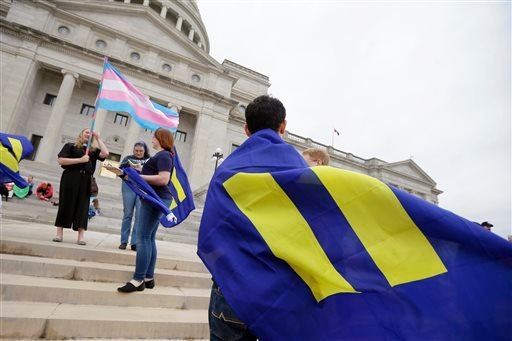 Demonstrators gather on the steps at the Arkansas state Capitol in Little Rock, Ark., Thursday, April 2, 2015. The measure passed in the committee. A reworked religious freedom bill passed earlier in the House Judiciary Committee. (AP Photo/Danny Johnston