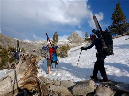 Left to right, Dane Shoemaker, Kelly Helgans, Jonathan Hayes and Ned White hike to the Pear Lake cabin in Sequoia National Park, March 29, 2015. (AP Photo/Brian Melley)