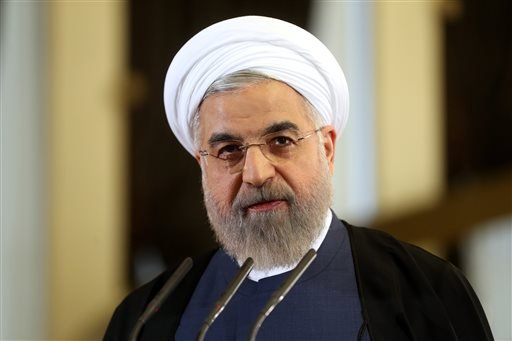 Iranian President Hassan Rouhani speaks in a news briefing at the Saadabad palace in Tehran, Iran, Friday April 3, 2015. Rouhani on Friday pledged that his nation will abide by its commitments in the nuclear agreement reached the previous day in Switzerla