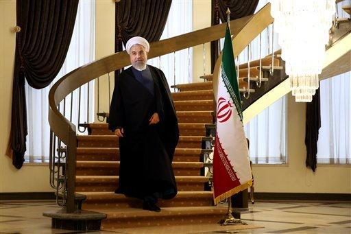 Iranian President Hassan Rouhani arrives for a news briefing at the Saadabad palace in Tehran, Iran, Friday April 3, 2015. Rouhani on Friday pledged that his nation will abide by its commitments in the nuclear agreement reached the previous day in Switzer