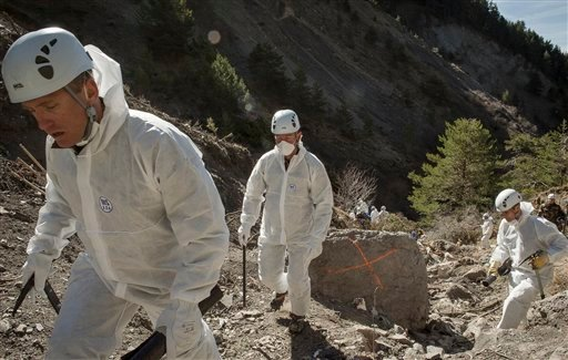 In this photo provided Friday, April 3, 2015 by the French Interior Ministry, French emergency rescue services work among debris of the Germanwings passenger jet at the crash site near Seyne-les-Alpes, France. The co-pilot of the doomed Germanwings flight