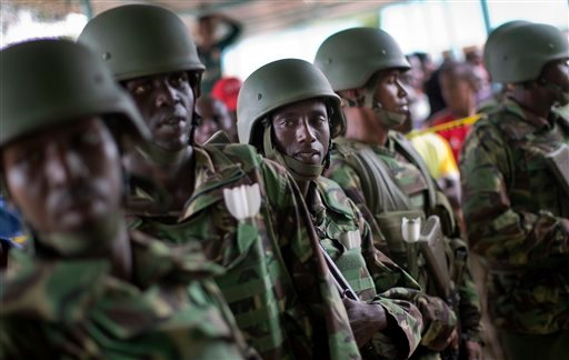 Kenya Defence Forces (KDF) soldiers arrive at a hospital to escort the bodies of the attackers to be put on public view, in Garissa, Kenya Saturday, April 4, 2015. Authorities displayed the bodies of the alleged attackers involved in the killings at Garis