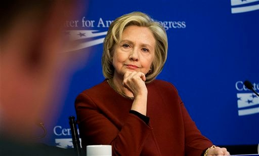 In this photo taken March 23, 2015, former Secretary of State Hillary Rodham Clinton listens during an event hosted by the Center for American Progress (CAP) and the America Federation of State, County and Municipal Employees (AFSCME), in Washington. A fi