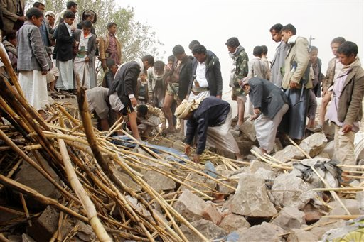Yemenis search for survivors in the rubble of houses destroyed by Saudi-led airstrikes in a village near Sanaa, Yemen, Saturday, April 4, 2015. Since their advance began last year, the Shiite rebels, known as Houthis have overrun Yemen's capital, Sanaa, a