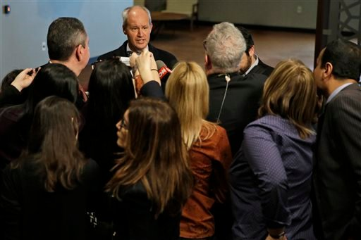 British Deputy Permanent Representative, to the United Nations Peter Wilson, top center, speaks to reporters as he arrives for a Security Council consultation on the situation in Yemen, Saturday, April 4, 2015, at U.N. headquarters. (AP Photo/Mary Altaffe