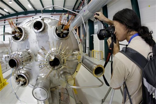 In this Aug. 7, 2010 file picture a photographer takes a picture in the assembly room of the elements of the LHC (large hadron collider) at the European Particle Physics laboratory CERN in Geneva, Switzerland The world's biggest particle accelerator is ab