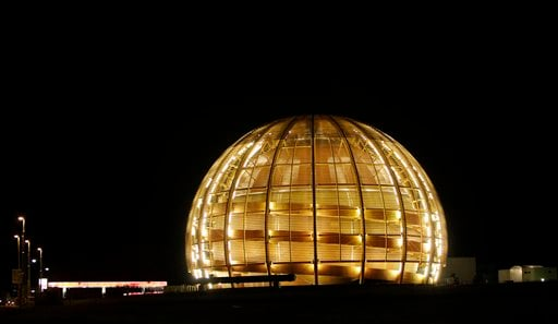 In this March 30, 2010 file picture the globe of the European Organization for Nuclear Research, CERN, is illuminated outside Geneva, Switzerland. The world's biggest particle accelerator is about to start up again after a two-year shutdown and upgrade.