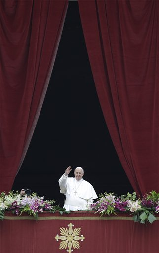 Pope Francis delivers the Urbi et Orbi (to the city and to the world) blessing at the end of the Easter Sunday Mass in St. Peter's Square at the Vatican , Sunday, April 5, 2015. (AP Photo/Andrew Medichini)
