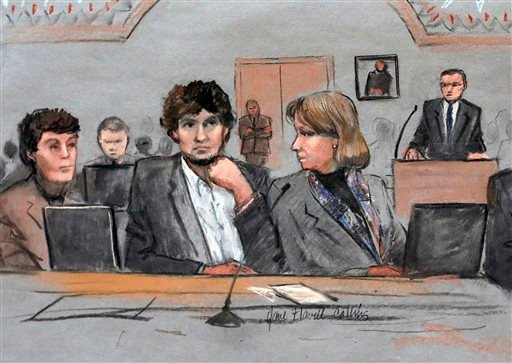 March 5, 2015 file courtroom sketch: Dzhokhar Tsarnaev, center, is depicted between defense attorneys Miriam Conrad, left, and Judy Clarke, right, during his federal death penalty trial in Boston. (AP Photo/Jane Flavell Collins, File)