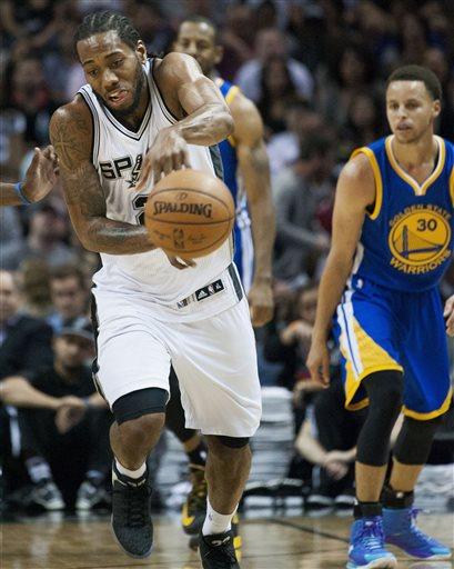 San Antonio Spurs forward Kawhi Leonard intercepts a pass during the second half of an NBA basketball game against the Golden State Warriors, Sunday, April 5, 2015, in San Antonio.