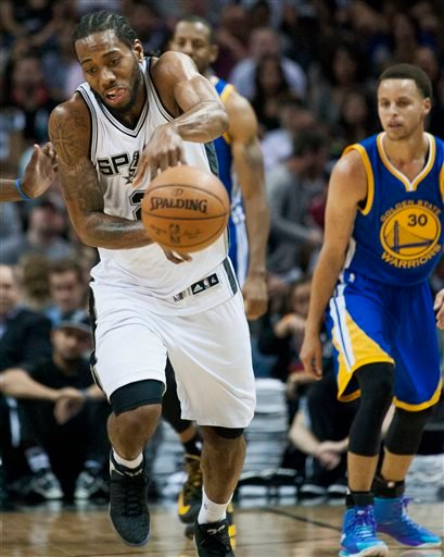 San Antonio Spurs forward Kawhi Leonard intercepts a pass during the second half of an NBA basketball game against the Golden State Warriors, Sunday, April 5, 2015, in San Antonio.