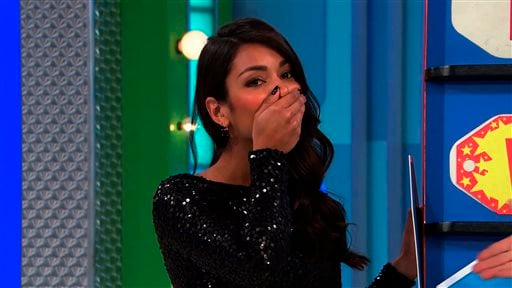 """In this photo provided by CBS, model Manuela Arbelaez ensured the price IS right...on the television show, """"The Price is Right,"""" by revealing the answer, on Thursday, April 2, 2015."""