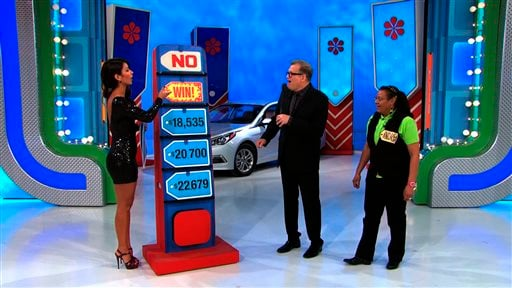 """In this photo provided by CBS, model Manuela Arbelaez ensured the price IS right...on the television show, The Price Is Right,"""" by revealing the answer."""