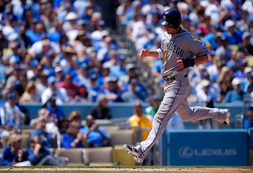 San Diego Padres' Wil Myers scores on a single by Matt Kemp during the first inning of an opening day baseball game against the Los Angeles Dodgers, Monday, April 6, 2015, in Los Angeles. (AP Photo/Mark J. Terrill)