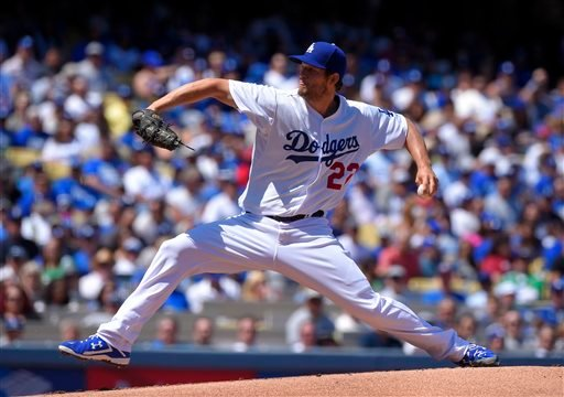 Los Angeles Dodgers starting pitcher Clayton Kershaw throws to the plate during the first inning of an opening day baseball game against the San Diego Padres, Monday, April 6, 2015, in Los Angeles. (AP Photo/Mark J. Terrill)