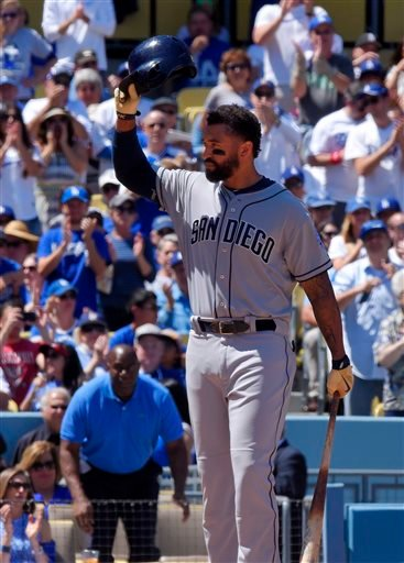 San Diego Padres' Matt Kemp tips his helmet to cheering fans as he comes to bat during the first inning of an opening day baseball game against his former team, the Los Angeles Dodgers, Monday, April 6, 2015, in Los Angeles. (AP Photo/Mark J. Terrill)