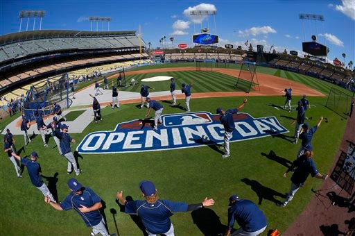 Members of the San Diego Padres warm up prior to an opening day baseball game against the Los Angeles Dodgers, Monday, April 6, 2015, in Los Angeles. (AP Photo/Mark J. Terrill)
