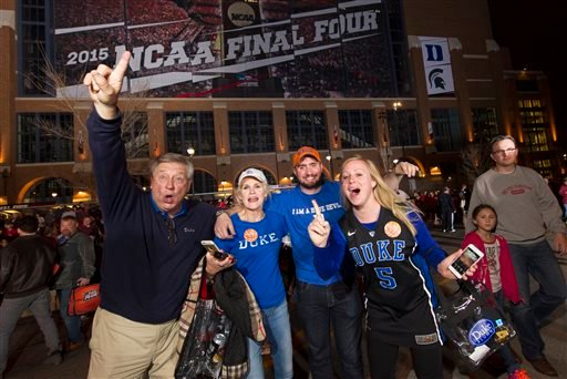 Duke fans celebrate outside Lucas Oil Stadium following Duke's win over Wisconsin in the NCAA Final Four college basketball tournament championship game Monday, April 6, 2015, in Indianapolis. (AP Photo/Doug McSchooler)