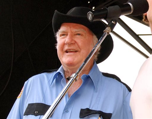 "June 4, 2005 file photo: ""Dukes of Hazzard"" cast member James Best sings during the DukesFest 2005 at the Bristol Motor Speedway in Bristol, Tenn. (AP Photo/Bristol Herald Courier, Earl Neikirk, File)"
