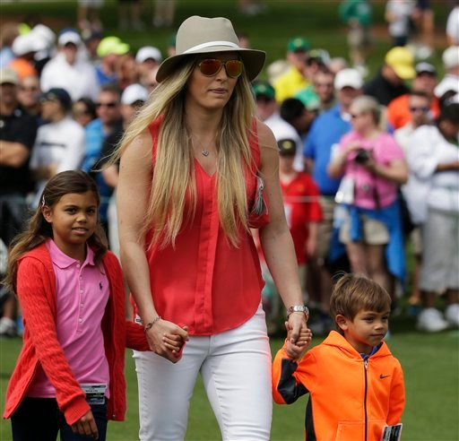 Lindsey Vonn walks with Tiger Woods' children Charlie, right, and Sam during a practice round for the Masters golf tournament Tuesday, April 7, 2015, in Augusta, Ga.