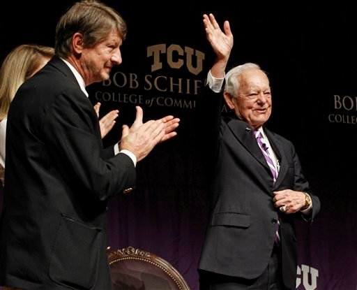Panelist P.J. O'Rourke, left, looks on as Bob Schieffer acknowledges audience applause after announcing his retirement from CBS News at the close of the Schieffer Symposium on the News at TCU.