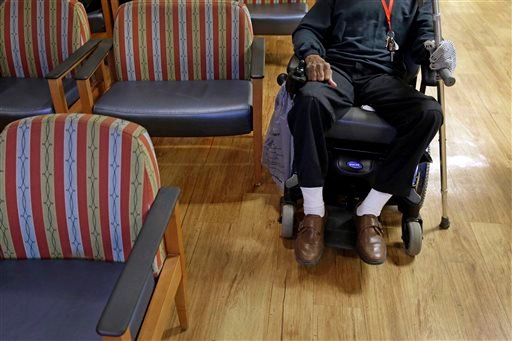 March 11, 2015 photo: U.S. Army veteran Henry Banks, Sr., waits for prescription drugs in a pharmacy waiting room inside the Fayetteville Veterans Affairs Medical Center in Fayetteville, N.C. (AP Photo/Patrick Semansky)