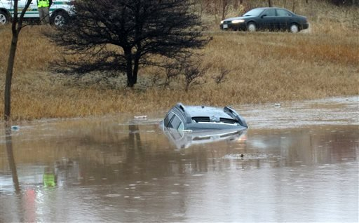 April 9, 2015 photo provided by the Ozaukee County, Wisconsin, Sheriff's Office are vehicles that became partially submerged in flood water due to heavy rain in Port Washigton, Wisconsin. (Ozaukee County Sheriff's Office via AP)